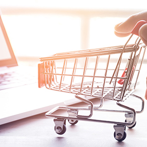 Online shopping and taxation concept with hand and cart