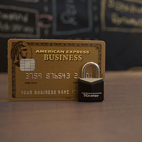 An American Express card with a lock in front of it
