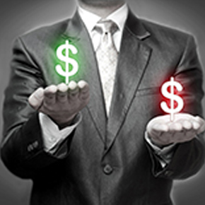 Man holding a dollar sign in red and a dollar sign in green