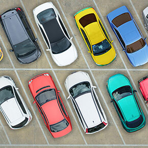 Different color vehicles in a parking lot
