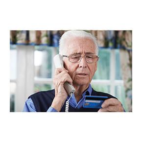 An elderly man on a phone