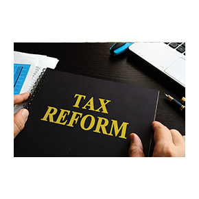 Tax Reform written on a book with someone holding it