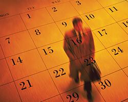 Man walking on a floor in orange portraying as a calendar