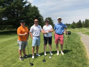 Brian Potter, Mikel Pompeii, Deb Finch and Alex Nitka posing at a golf event