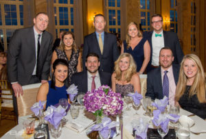 Partners and employees of Dannible & McKee at a gala event