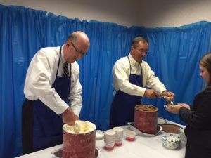 Partners of Dannible & McKee, Chris Didio and Brian Johnson scooping and serving ice cream
