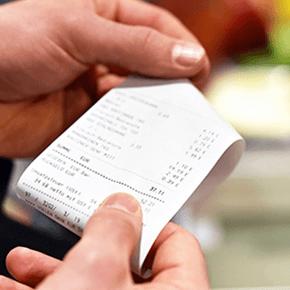 Hands holding a receipt