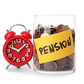 Red alarm clock next to a jar of coins with pension written on a sticky note
