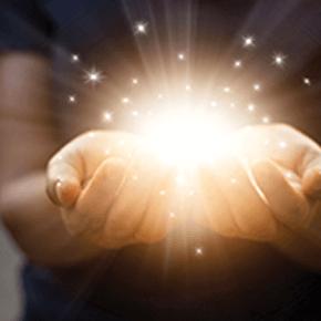 Pair of hands holding illuminated rays of light
