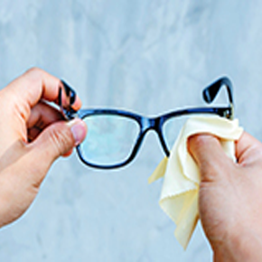 Person cleaning glasses
