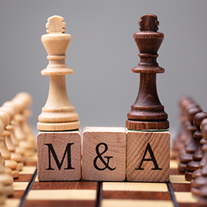Chess Board with pawns on top of M&A wooden blocks