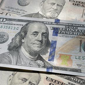 Hundred dollar bill and 50 dollar bill