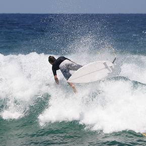 Man surfing taking a spill