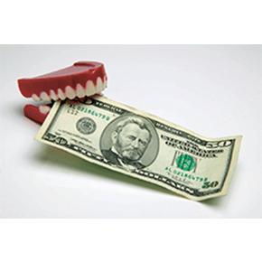 Toy denture biting a $50 bill