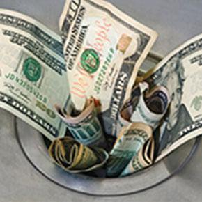 Money stuffed In opened part of sink drain