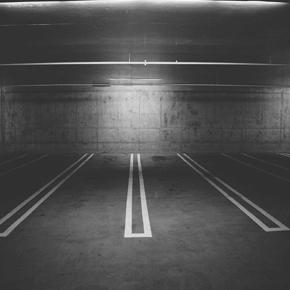 A dark parking garage with open spaces
