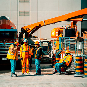 Construction Workers on Site in front of equipment