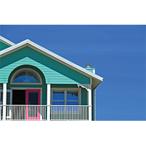 Beach house balcony with bright color house painted