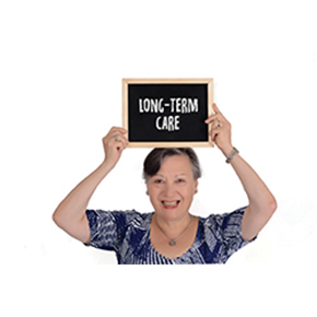 Older woman holding LongTerm Care Sign