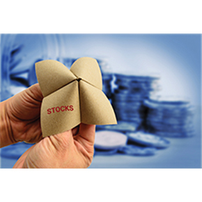 Paper fortune teller showing stocks written on it with coins in the background