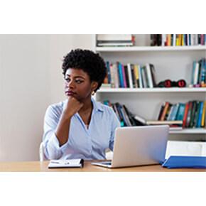 Woman at computer thinking
