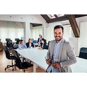 Man smiling at meeting