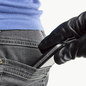 Hand in black glove grabbing phone out of back pocket of someone