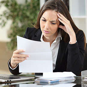 Woman looking at papers intensely