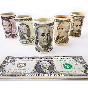 5 rolled dollar bills - one roll each of $2, $5, $10, $20, $50 and a $1 bill laying flat in front of those rolled behind
