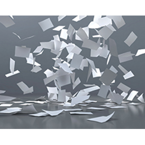 Pieces of gray and white paper flying around