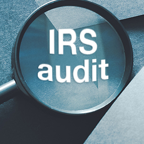 magnifying glass with IRS Audit written on it