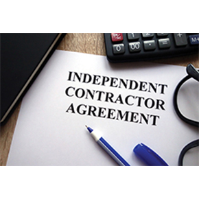 Contractor agreement paperwork written on white paper with partial pen, calculator and glasses