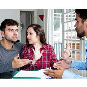 couple talking with agent looking upset