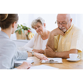 Older couple looking over papers with adviser