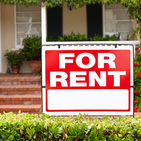 A for rent sign in front of house