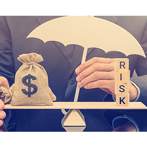 Man sitting with a scale with blocks on one side spelling RISK and a money bag with dollar symbol on it and his hand holding an umbrella