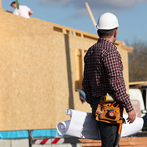 Construction man looking at structure being built