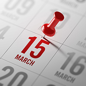 Calendar with March 15 written in Red with Red tack