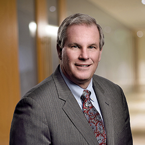 Michael J. Reilly, managing partner of Dannible & McKee, LLP headshot in office setting