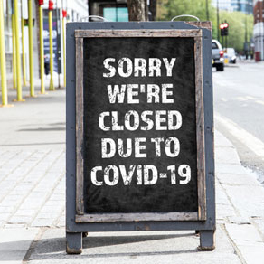 Store sign with words sorry were closed due to COVID-19