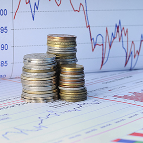 Stacks of coins with financial charts