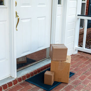 Three boxes on brick porch stacked in front of front door