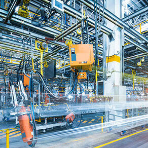 Manufacturing plant with blue and orange colored machinery