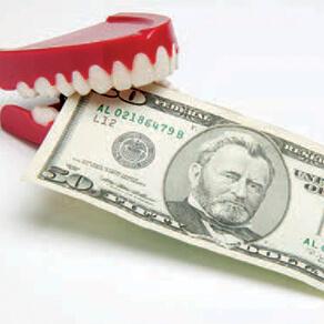 Fake dentures with $20 bill between teeth