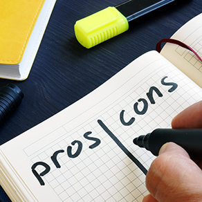Man is writing list of pros and cons with a black marking pen