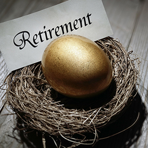 Golden egg in nest with slip of paper behind with the word retirement on it in calligraphy