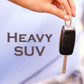 Womans hand holding car key with