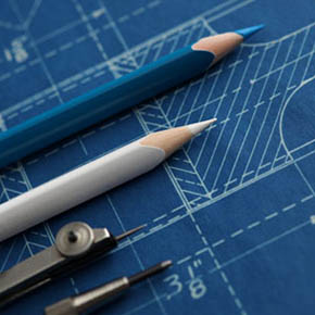 Blueprint with drawing pencils and stencils