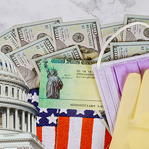 Capitol building, $100 bills, face mask, surgical glove, and part of the American flag COVID relief