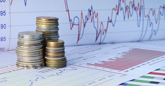 Stack of coins with financial charts for business valuations